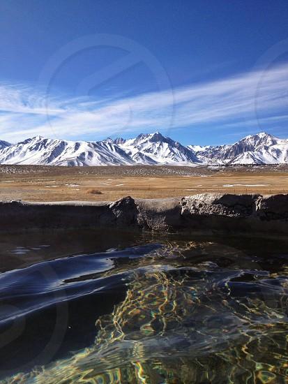 Hot springs soaking. Mountains. Summer. Travel. Fun. Nature.  photo