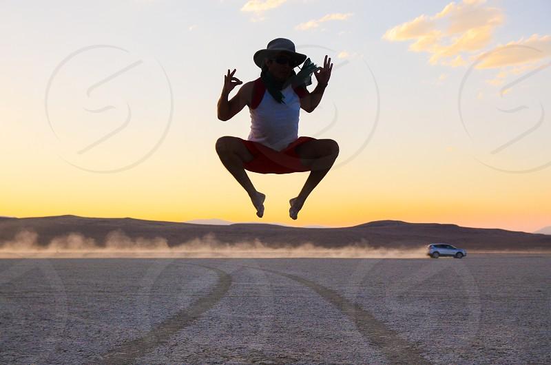 wanderlust jump sunset desert happy travel man photo