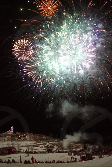 Fireworks seen from the ski slopes in a small village in Southern France. photo