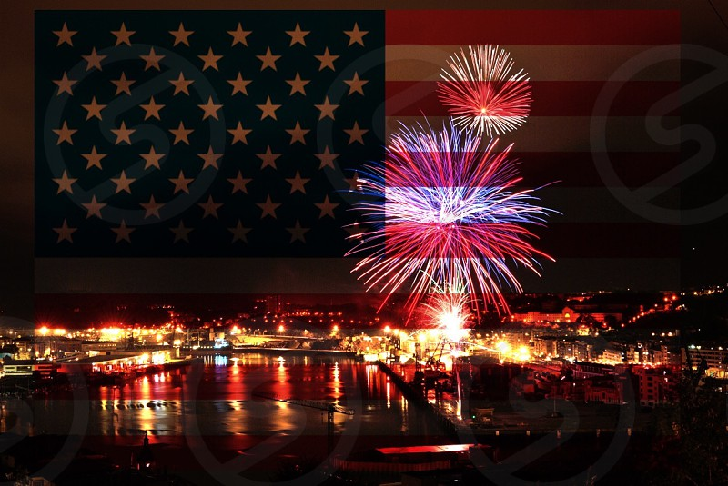 u.s.a flag with fireworks display at nighttime photo
