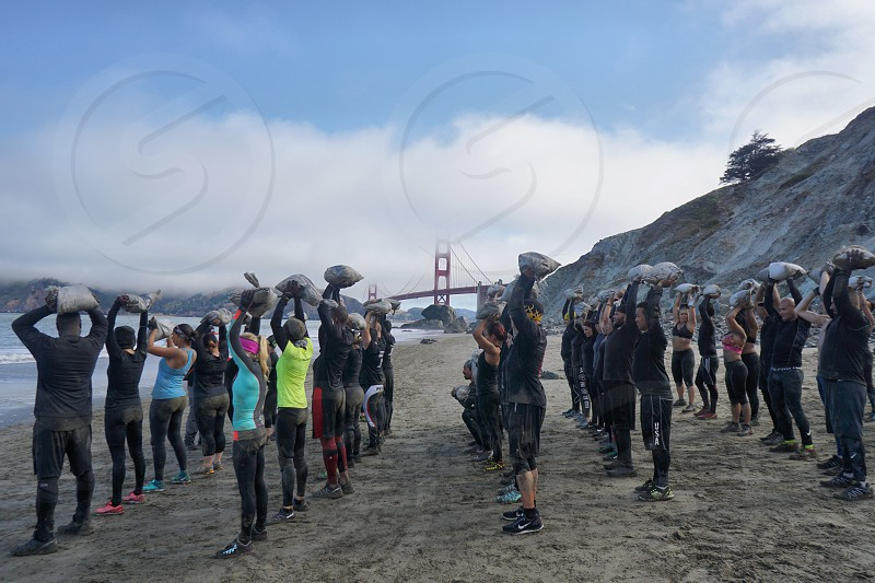Group exercise San Francisco beach  photo