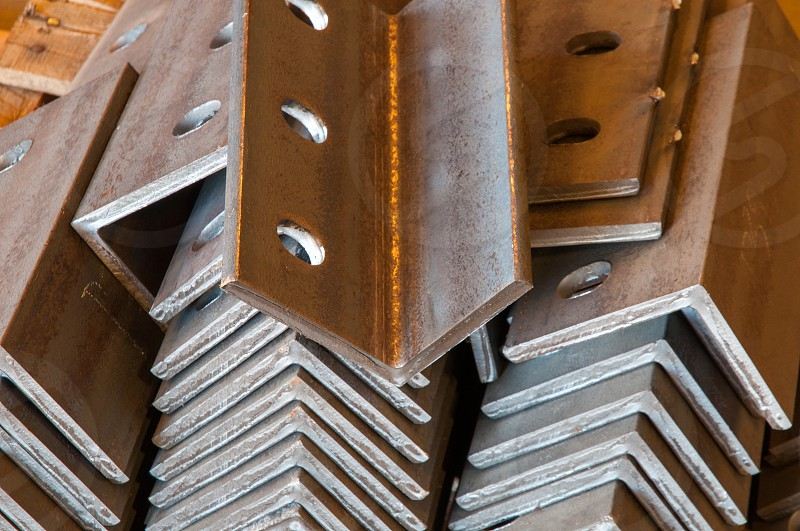 Rusted steel parts with drilled holes photo