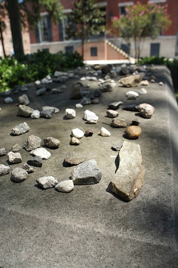 white gray brown stones on top of gray concrete surface photo