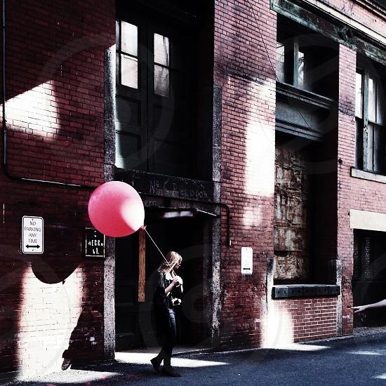 woman holding balloon photo