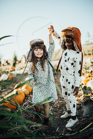 Pumpkin patch fall cozy kids playing children dancing photo