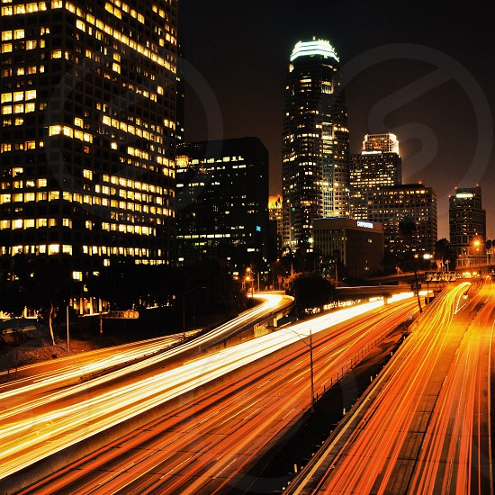 Night cityscape with fast foward traffic photo