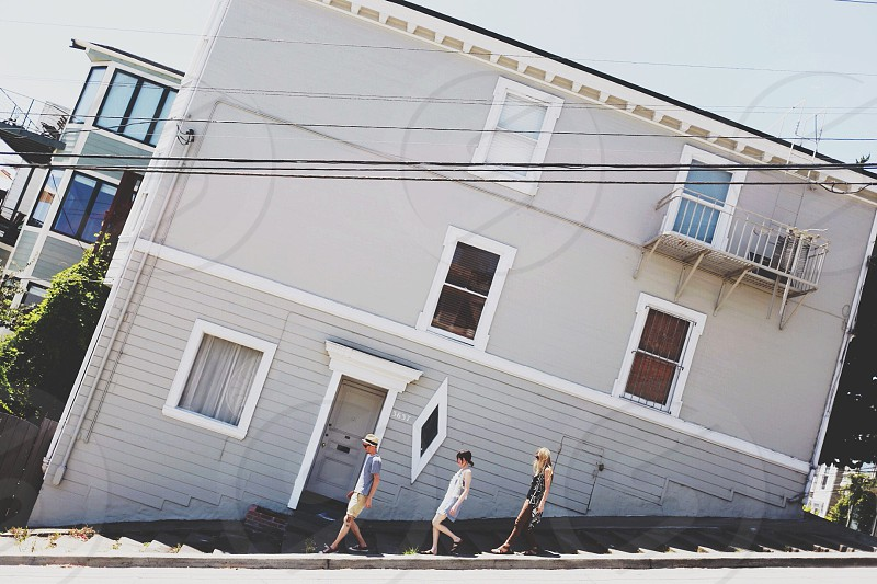 man and 2 women walking down stairs photo