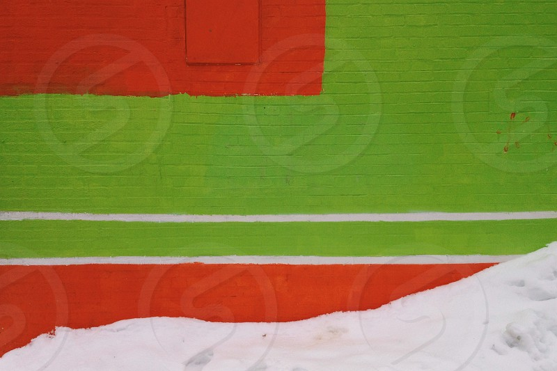 wall brick paint green orange snow white line abstract mural urban photo