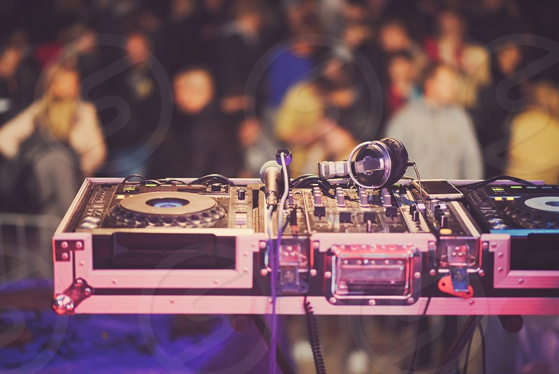 DJ Mixing Console with Microphone and Headphones on the Stage photo