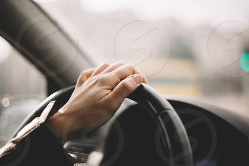 Hand on the wheel driving a car photo
