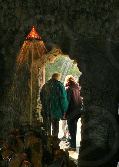 man wearing green jacket standing in front of woman wearing brown jacket photo
