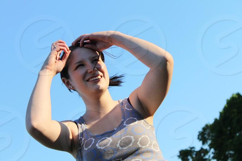 woman wearing gray tank top photo