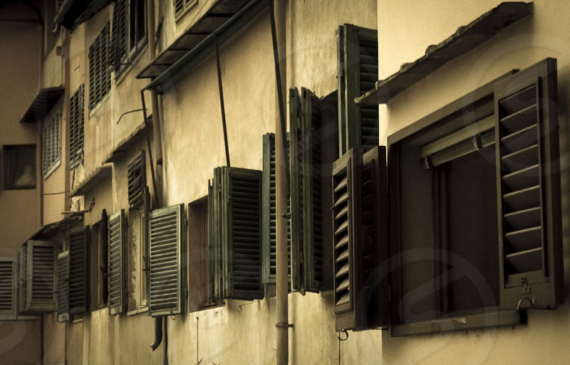 Old windows of the Ponte Vecchio in Florence in Tuscany photo