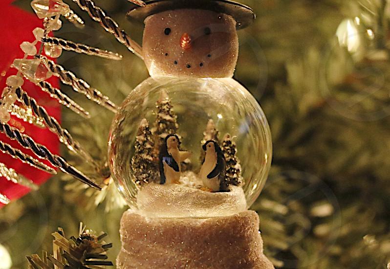 Snowglobe snowman ornament Christmas tree decoration holiday penguins winter scene  photo