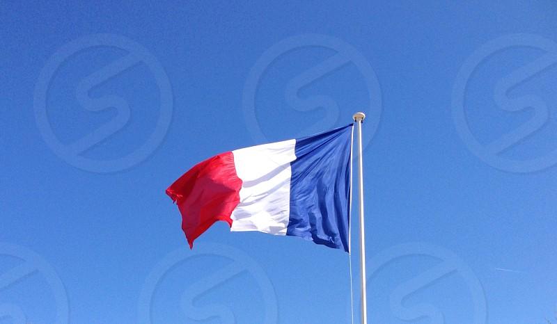 Flag France French red white blue stripes flagpole sky  photo