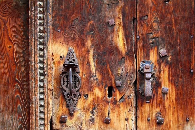 aged grunge wood door weathered old rusty handle lock photo