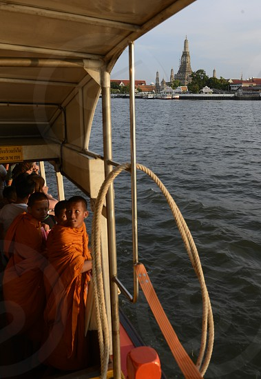 the temple of Wat arun at the Chao Phraya river in the city of Bangkok in Thailand in Southeastasia. photo