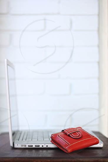 Red leather wallet with laptop photo