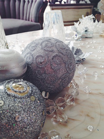 grey round ornament on table photo