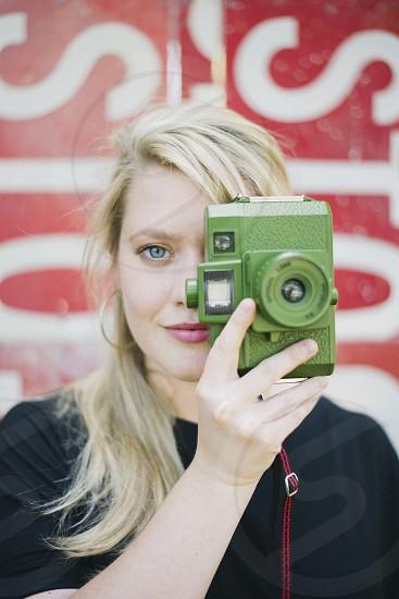 woman holding camera photo