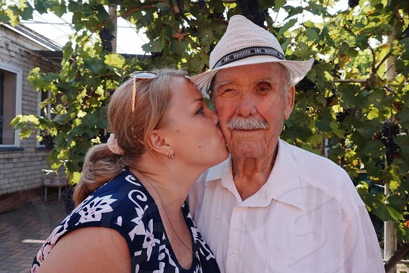 Grateful gratefulness grandfather grandpa family granddaughter kiss kissing  photo