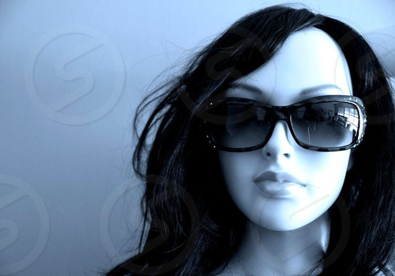 mannequin head wearing black sunglasses and black hair wig photo