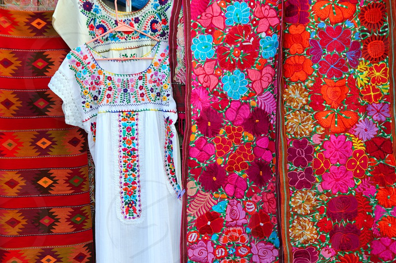 colorful Mexican serape embroidery fabric and Chiapas dress Mexico photo