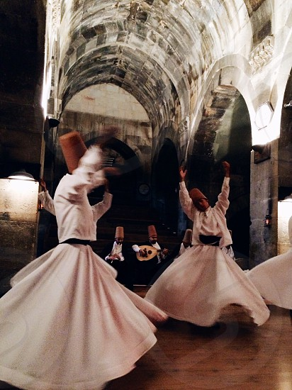 Whirling Dervishes in Cappadocia Turkey  photo