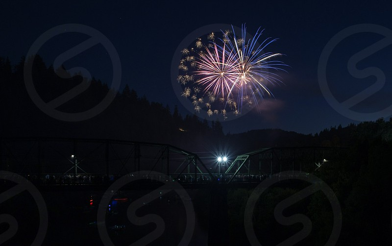 fireworks bridge river small town 4th of July photo