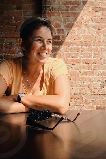 women's yellow round neck shirt photo
