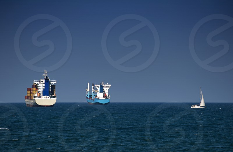Commercial container ships on blue sky photo
