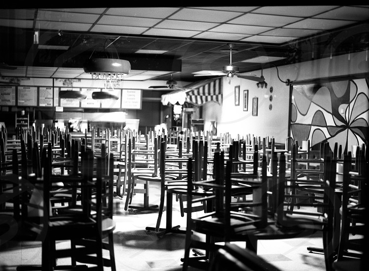 restaurant black white b&w chairs repetition contrast vacant photo
