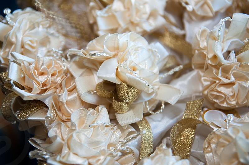 white ribbon flowers with gold ribbons photo