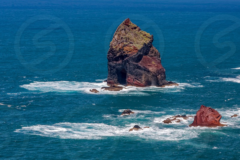 Rocky outcrops at St Lawrence in Madeira showing unusual clouration photo