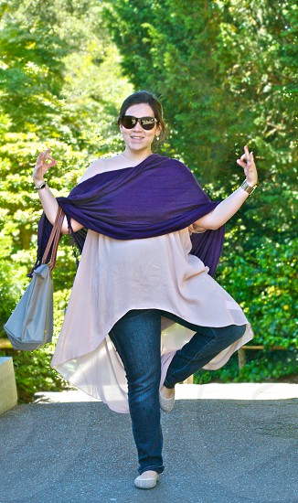 woman wearing a black shawl standing on one foot photo