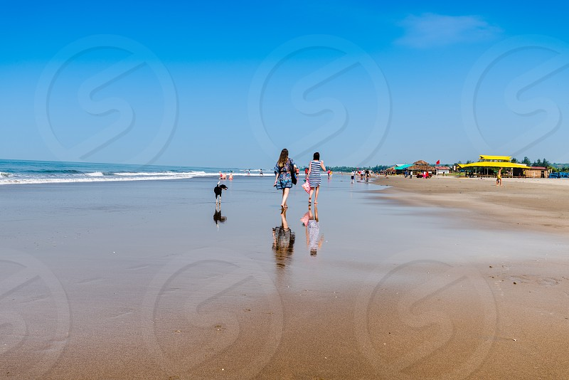 Tourist enjoying at Goa Beach photo