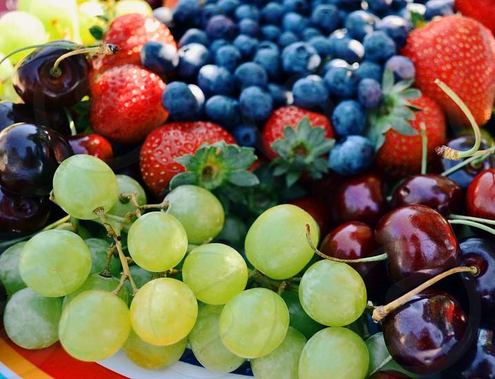 Fruit plate of fruit fruit basket food grapes blueberries strawberries cherries health healthy  photo