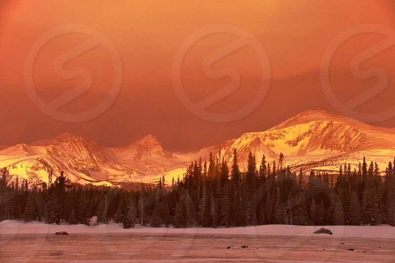 Sunrise snow squall at Red Rock Lake in Indian Peaks Wilderness area near Nederland in Boulder County Colorado photo