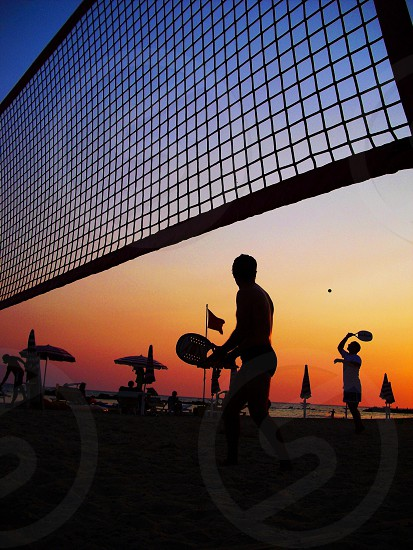 people and volleyball net silhouette photo
