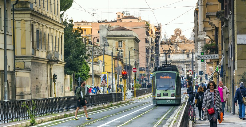 trams along via Flaminia with Piazza del Popolo in the distance photo