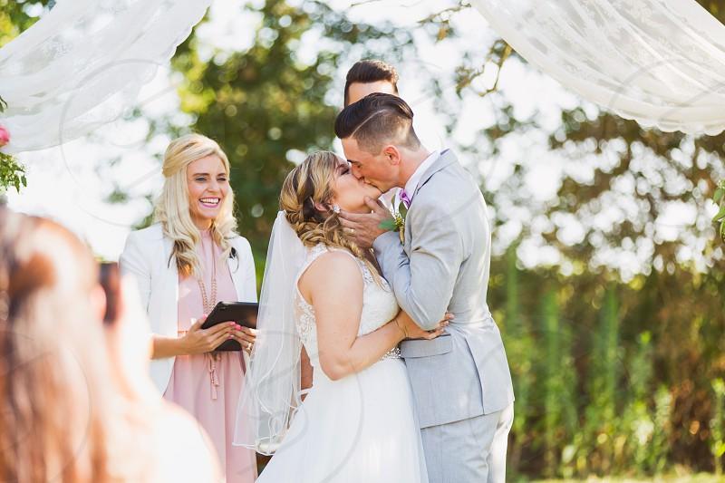 newlywed couple kissing photo