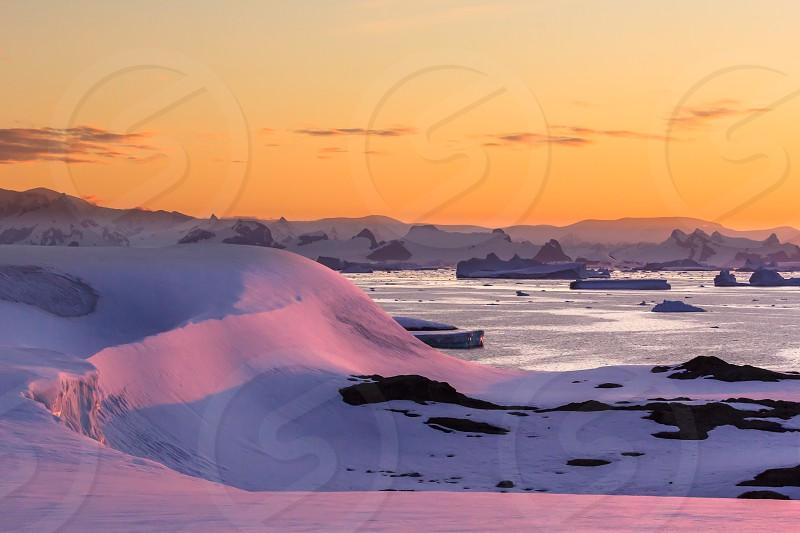 Sunset intense colorful Antarctica peninsula iceberg ice water ocean snow nature expedition adventure  photo