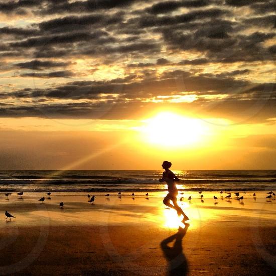 Sunrise beach runner. Ormond Beach Florida.  photo