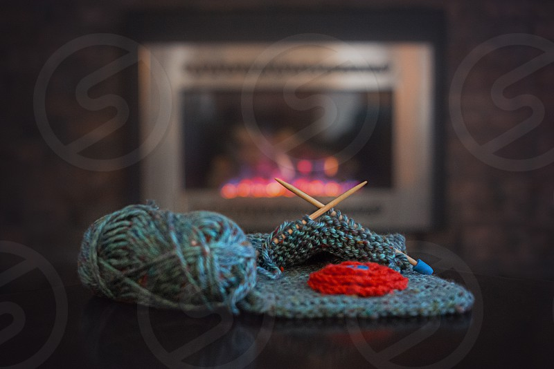 Knitting by the Fireplace photo