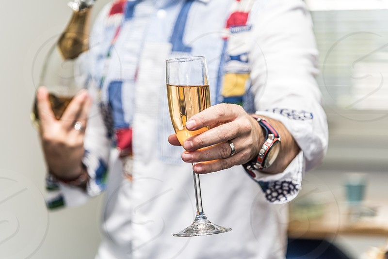 Celebrating event in an office with a bottle of champagne. photo