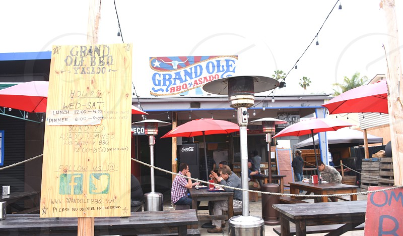 persons eating on grand ole bbq and asado store during daytime photo