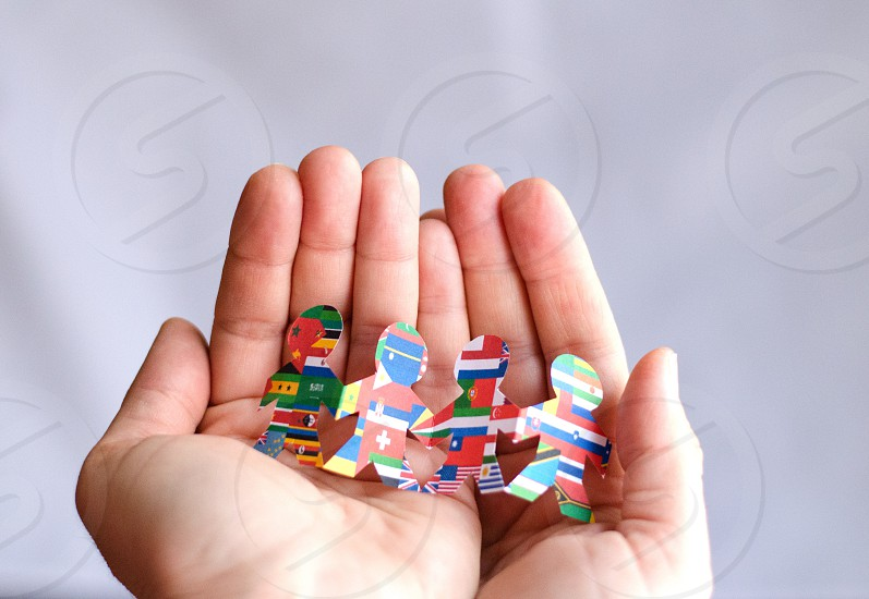 Girl hands Nations care togetherness world flags people  photo