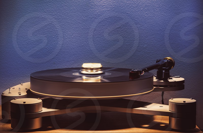Details of modern gramophone in work dark ambient accentuated shapes with illumination. photo
