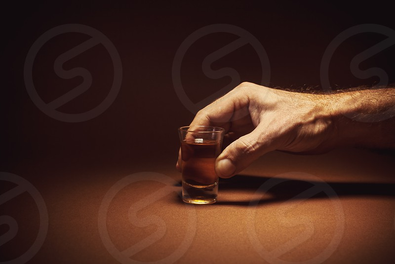 Conceptual composition alcohol drink in a glass.  photo