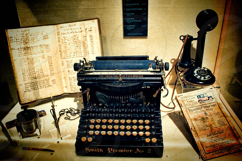 Still life with vintage typewriter telephone and address book. photo